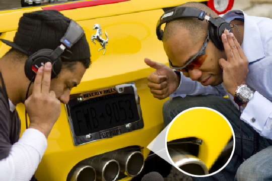 Carlyle Murciélago (right) with an assistant, miking a Ferrari automobile with a B3 Lavalier
